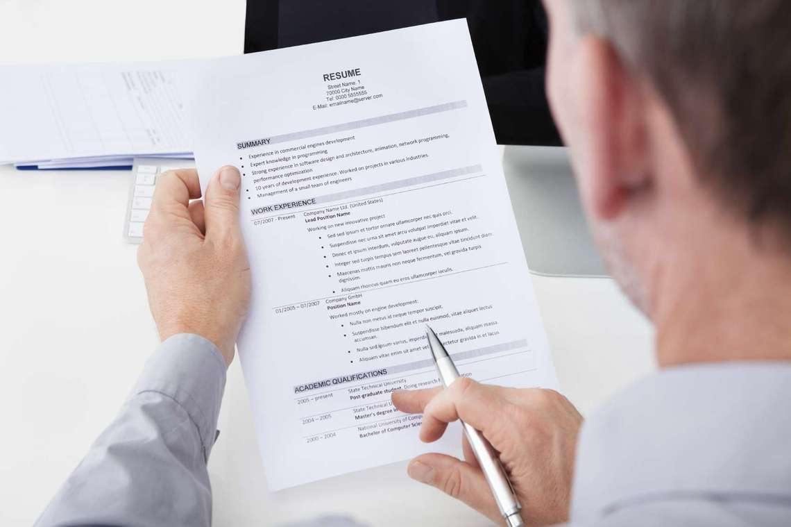 Man Holding A Resume On Resume Check