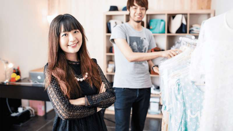 Retail workers in a dress shop