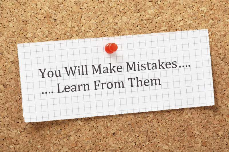 Learn from your mistakes corkboard.