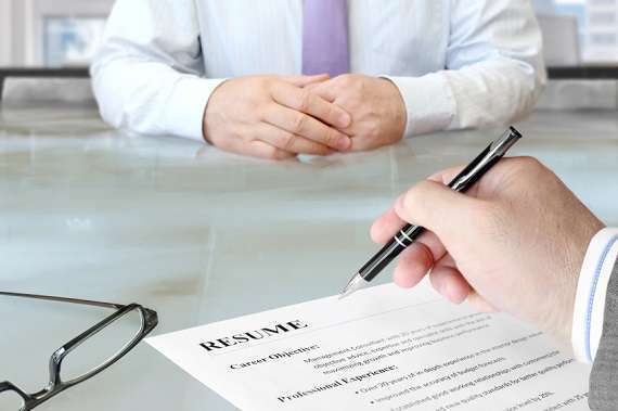 Man reviewing resume in an interview