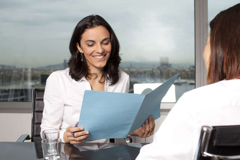 Woman recruiter reviews candidate documents